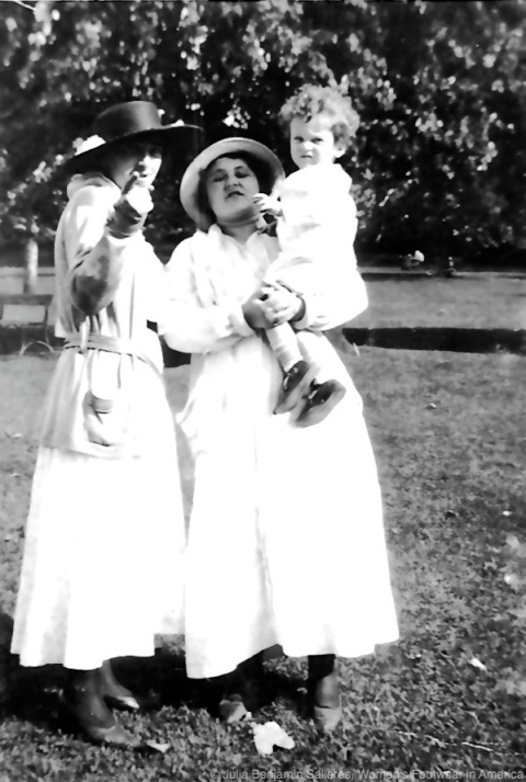 My grandmother holding my father.